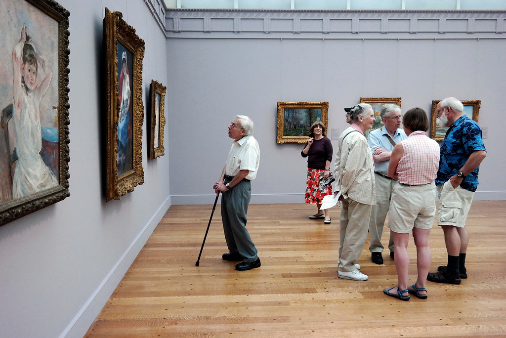 Description of . Visitors enjoy the Renoir Room at the Clar Art Institute.  The existing gallery spaces have improved lighting and flow.  Tuesday July 1, 2014.  Ben Garver / Berkshire Eagle Staff / photos.berkshireeagle.com