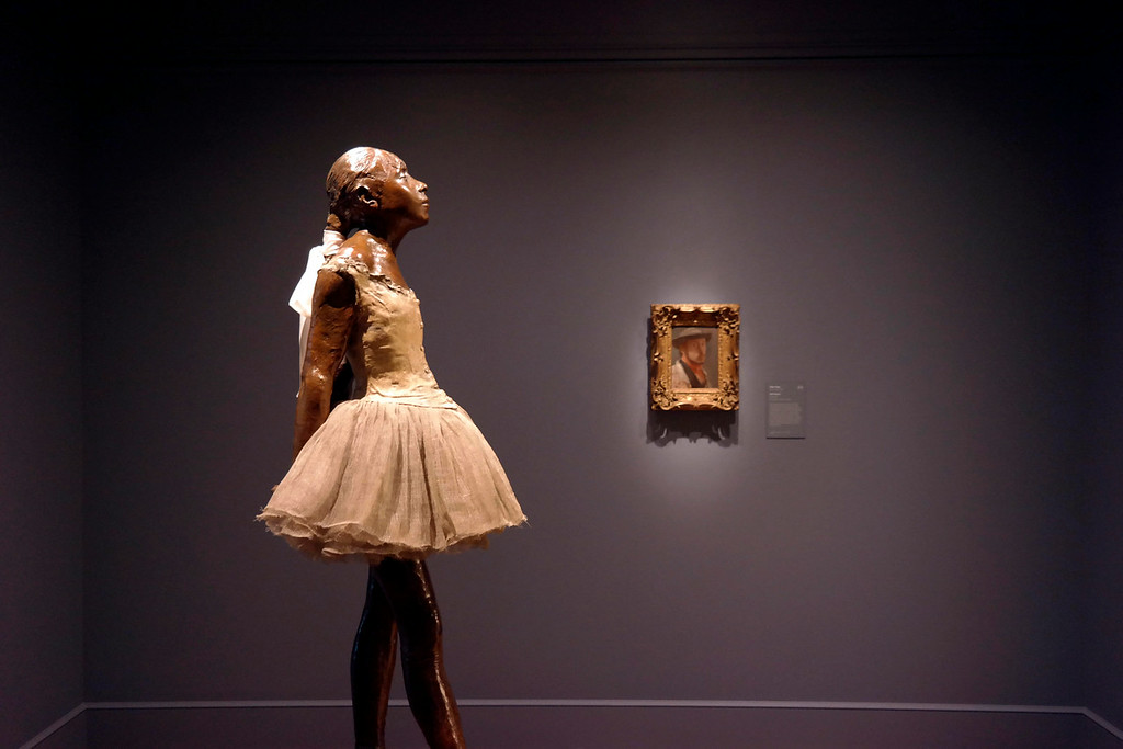 Description of . The Little Dancer by Degas has her own room in the Clark Art Institute, Tuesday July 1, 2014. A protrait of the artist is in the background.  Ben Garver / Berkshire Eagle Staff / photos.berkshireeagle.com