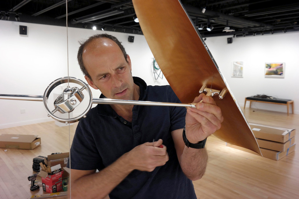 Description of . Sculptor Pedro S. de Movellian installs his kinetic sculpture at the Berkshire School's Fine Arts Center in Scheffield. Wednesday May 7, 2014.  Ben Garver / Berkshire Eagle Staff / photos.berkshireeagle.com