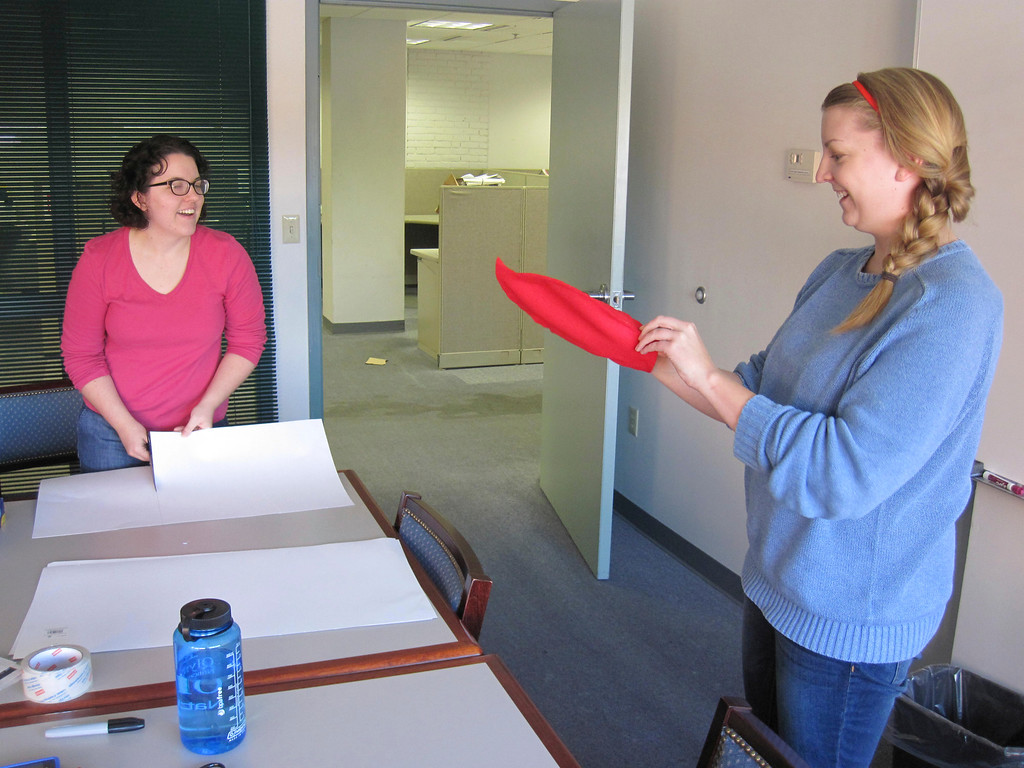 Description of . Eagle features editor Lindsey Hollenbaugh (left) and online editor Laura Lofgren (right) work on creating a do-it-yourself 'Lobster-in-a-Pot' costume for last week's Third Thursday festival. Jenn Smith/Berkshire Eagle Staff Oct. 18, 2013