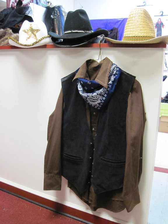 Description of . An already owned button-down shirt, vest and bandana paired with blue jeans and a hat equals an instant cowboy costume. Jenn Smith/Berkshire Eagle Staff Oct. 18, 2013