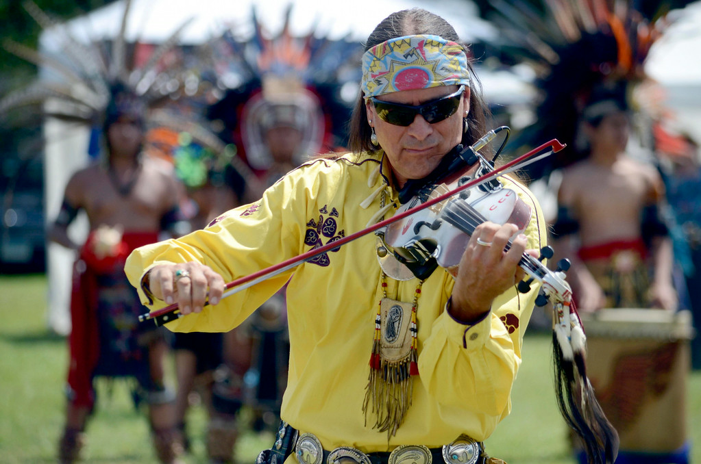 Description of . Arvel Bird performs a fusion of Celtic and Native American traditions at the Rock, Rattle and Drum Pow Wow in Adams, Mass., Sun. Aug. 10. 2014.  The annual event draws people from all over the Northeast to celebrate native American Traditions. (AP Photo / The Berkshire Eagle, Ben Garver)