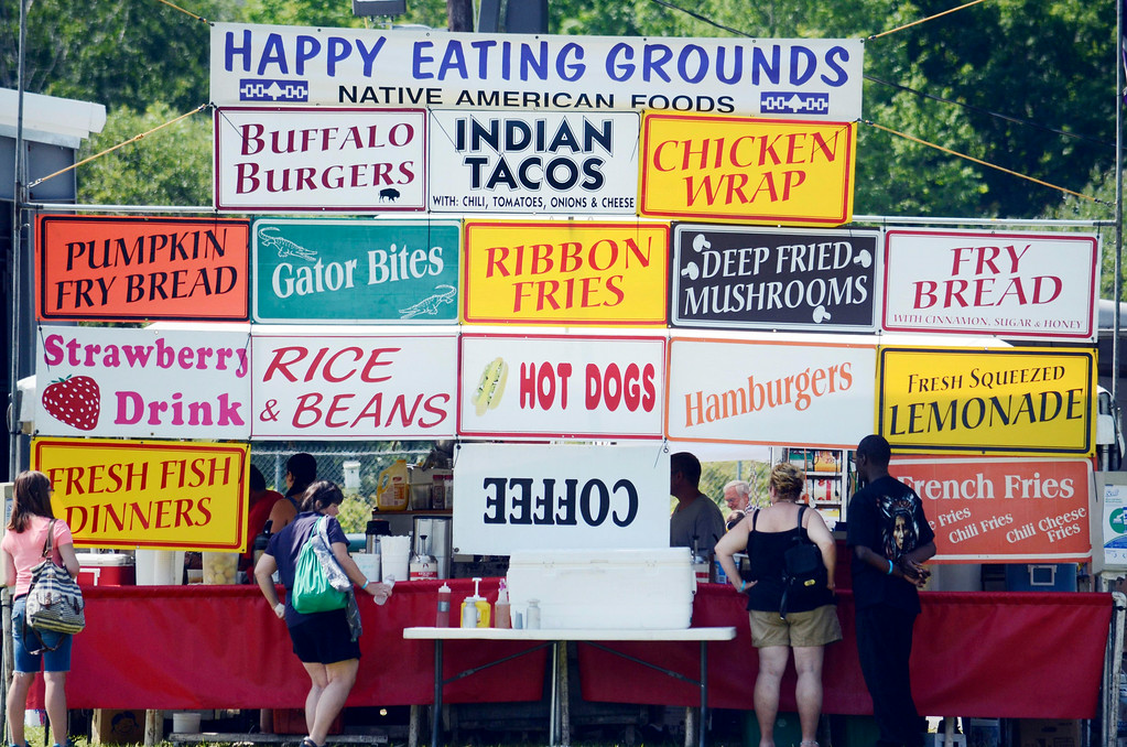 Description of . A mix of tradition and contemporary foods feed visitors to the Rock, Rattle and Drum Pow Wow in Adams, Mass., Sunday Aug. 10, 2014.  THe event draws celebrants of Native American traditions form around the Northeast.  (AP Photo / The Berkshire Eagle, Ben Garver)