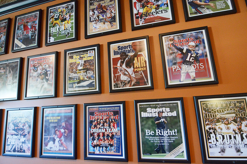 Description of . A collection of historic and contemporary Sports Illustrated covers decorate Mazcots in Lenox, Friday September 20, 2013. Ben Garver / Berkshire Eagle Staff