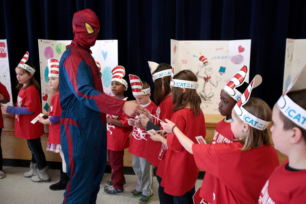 Description of . Spiderman hands out free tickets to the Pittsfield Suns to second-graders at Williams Elementary School in Pittsfield during an anti-violence and anti-bullying program. Wednesday, March 26, 2014. Stephanie Zollshan / Berkshire Eagle Staff / photos.berkshireeagle.com