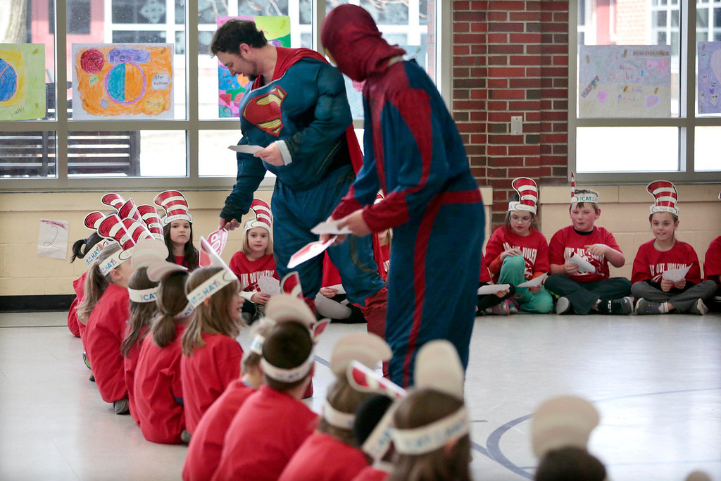 Description of . Superman and Spiderman hand out 'stop bullying' cards to the second grade class at Williams Elementary School in Pittsfield during an anti-violence and anti-bullying program. Wednesday, March 26, 2014. Stephanie Zollshan / Berkshire Eagle Staff / photos.berkshireeagle.com