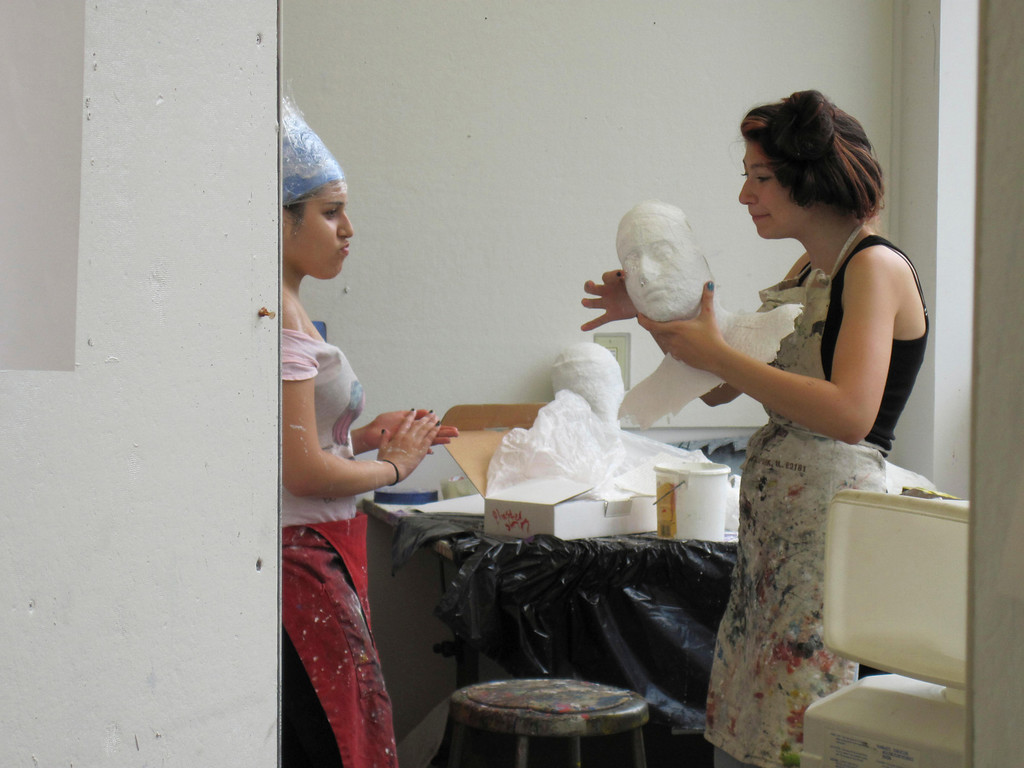 Description of . Eden Zohar (right), 15, shows Dania Birakh, 15, the plaster cast she made of Birakh's face. The students are participating in the summer session of Artsbridge, hosted by Buxton School in Williamstown. The program uses art and dialogue to develop constructive partnerships between Israeli, Palestinian and American youth. Sunday, July 21, 2013 Jenn Smith/Berkshire Eagle Staff