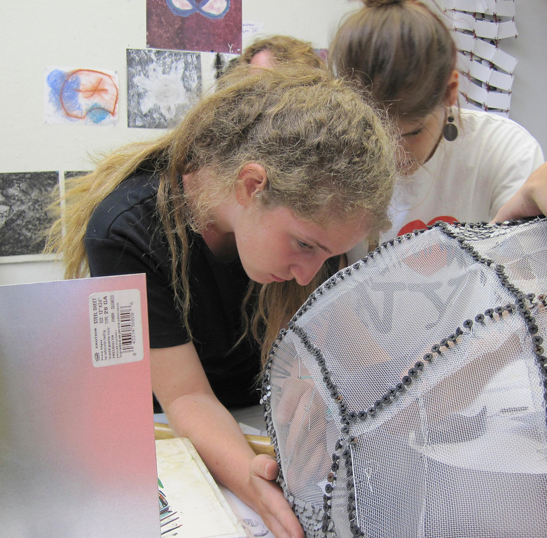 Description of . Students create a sculpture using steel mesh, sheet metal and nails while participating in the summer session of Artsbridge, hosted by Buxton School in Williamstown. The program uses art and dialogue to develop constructive partnerships between Israeli, Palestinian and American youth. Sunday, July 21, 2013 Jenn Smith/Berkshire Eagle Staff