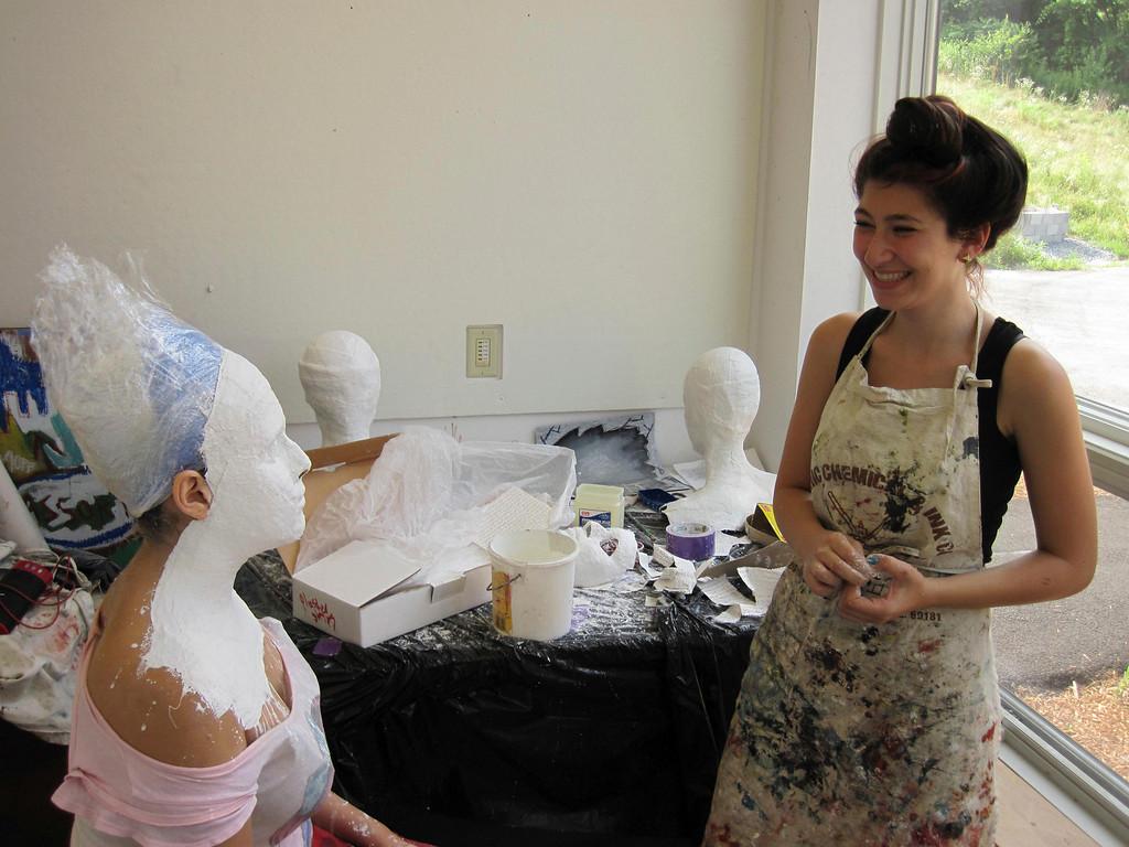 Description of . Eden Zohar, 15, steps back to admire the plaster cast she made of the face of Dania Birakh, 15 as part of a summer session of Artsbridge, hosted by Buxton School in Williamstown. The program uses art and dialogue to develop constructive partnerships between Israeli, Palestinian and American youth. Sunday, July 21, 2013 Jenn Smith/Berkshire Eagle Staff