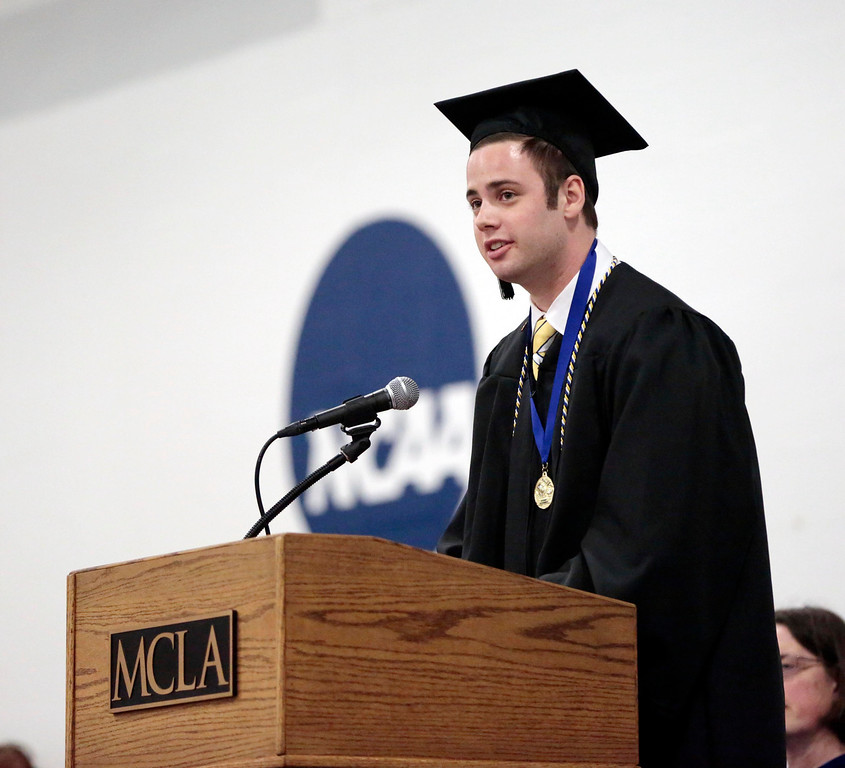 Description of . Class of 2014 student president Jake Powers speaks to his classmates during the MCLA commencement ceremony in North Adams. Saturday, May 17, 2014.