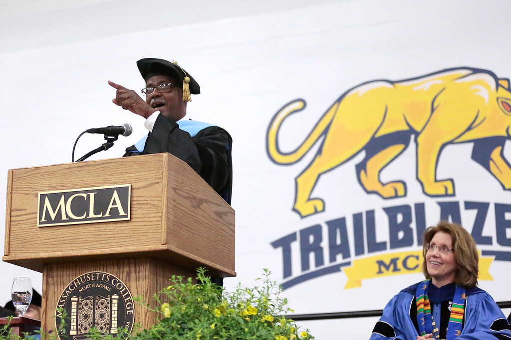 Description of . Charles Desmond delivers the commencement address to the graduates during the MCLA commencement ceremony in North Adams. Saturday, May 17, 2014.