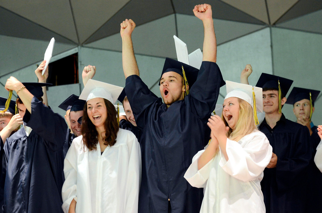 Description of . Mount Everett School graduates cheer at the end of commencement at Tanglewood in Lenox, Saturday June 7, 2014.  Ben Garver / Berkshire Eagle Staff / photos.berkshireeagle.com