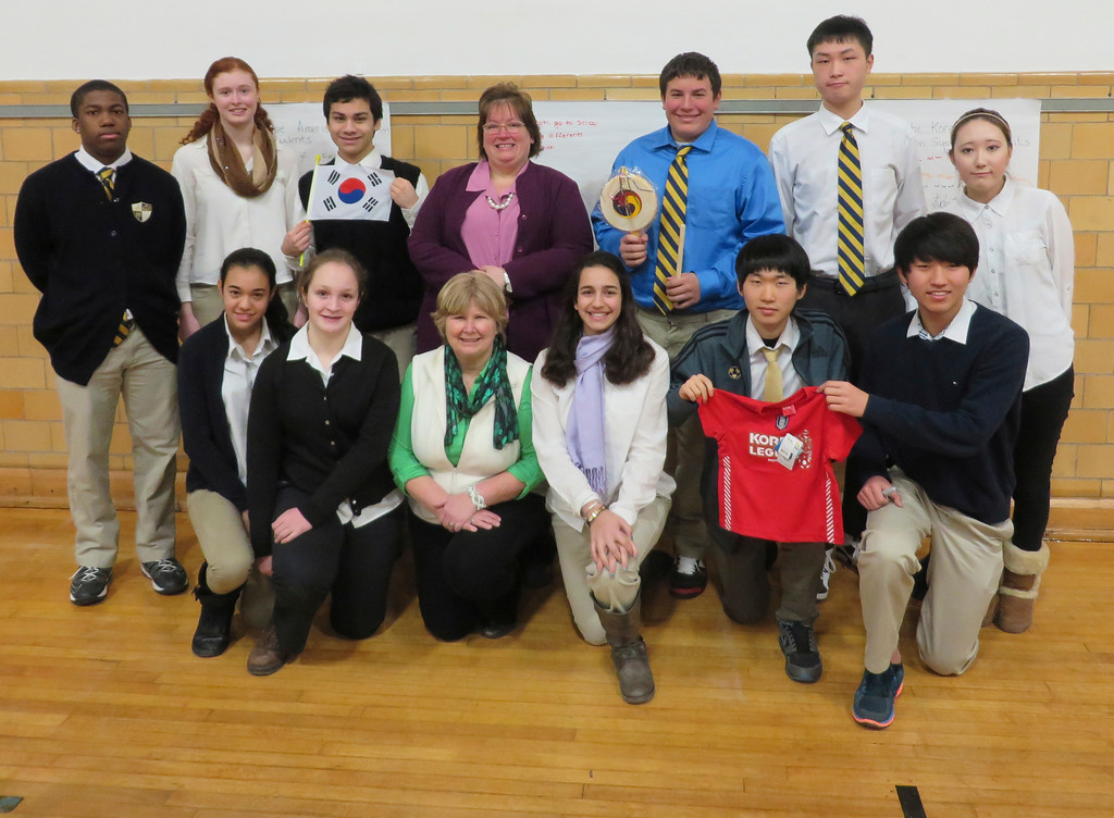 Description of . Christine Canning-Wilson, a Berkshire-based international education consultant (center, top row), recently visited St. Joseph Central High School to present a workshop to foster more understanding between the school's exchange students from South Korea and China, and American students. Canning-Wilson recently traveled to South Korea to work with schools and parents. Jenn Smith/Berkshire Eagle Staff