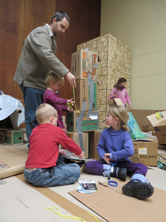 Description of . Dan Shustack of North Adams helps Josephine Shustack, William Shustack and Mia Holmgren work on a cardboard box tower as part of the Ten Days of Play exhibit at the Berkshire Museum in Pittsfield. Jenn Smith/Berkshire Eagle Staff Monday, Feb. 17, 2014