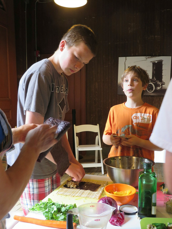 Description of . Liam Nester, 13 (left) and Theo Maurino, 10, watch and learn how to make nori rolls in The Nutrition Center's Food Adventures summer camp at The Mount in Lenox. Jenn Smith/Berkshire Eagle Staff/photos.berkshireeagle.com Thursday, July 3, 2014