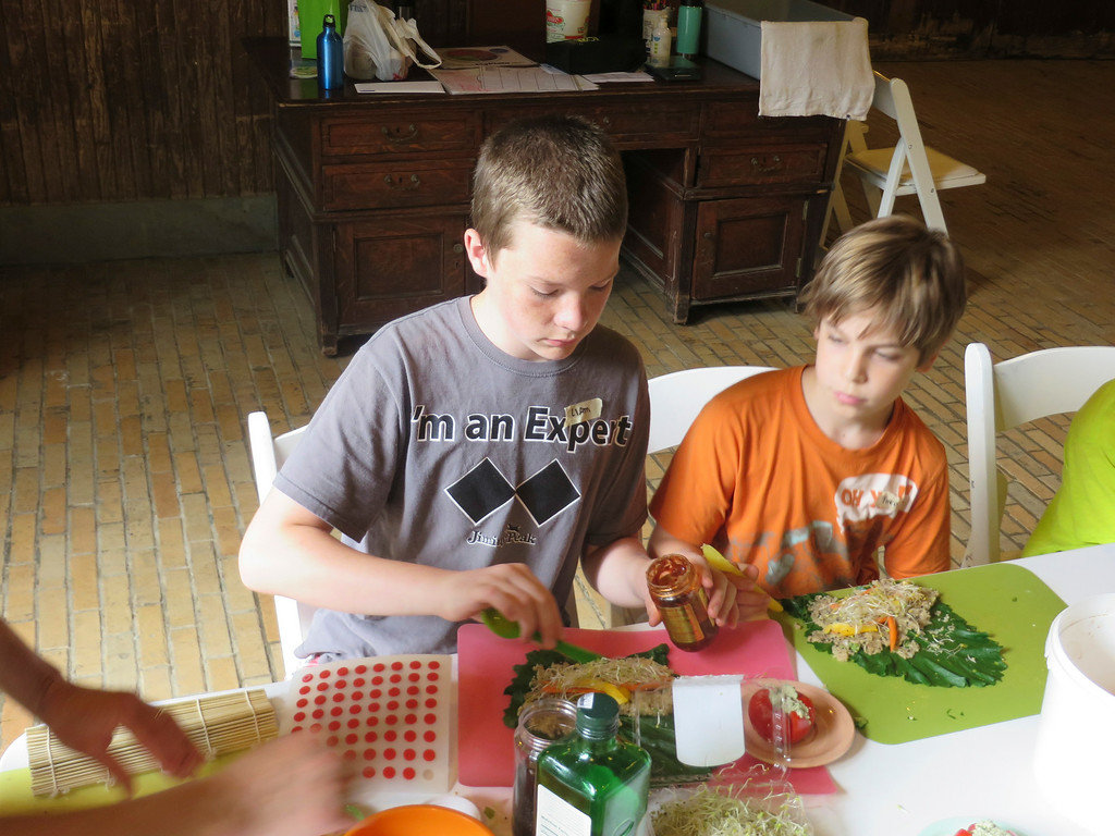 Description of . Liam Nester, 13, and Theo Maurino, 10, add a hot sauce to their vegetable and grain sushi rolls made in The Nutrition Center's Food Adventures summer camp at The Mount in Lenox. Jenn Smith/Berkshire Eagle Staff/photos.berkshireeagle.com Thursday, July 3, 2014