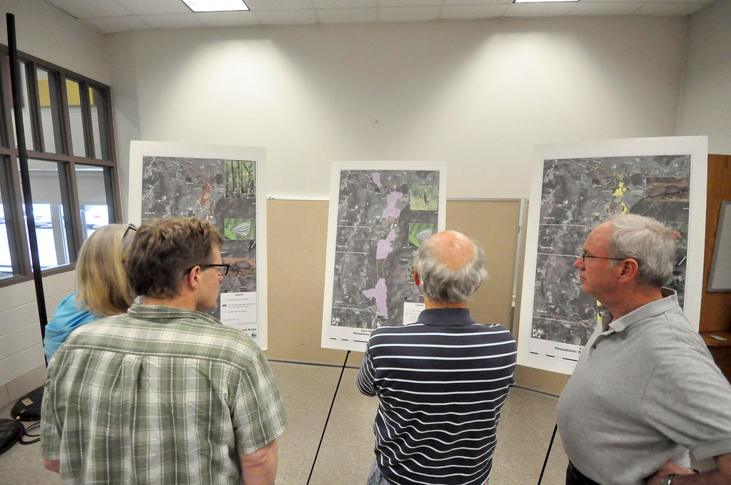 Description of . People look at some poster boards that outline the proposed PCB clean up of the Housatonic River prior to a meeting at Lenox Memorial Middle and High School on East Street on Wednesday, June, 18, 2014. Gillian Jones / Berkshire Eagle Staff / photos.berkshireeagle.com