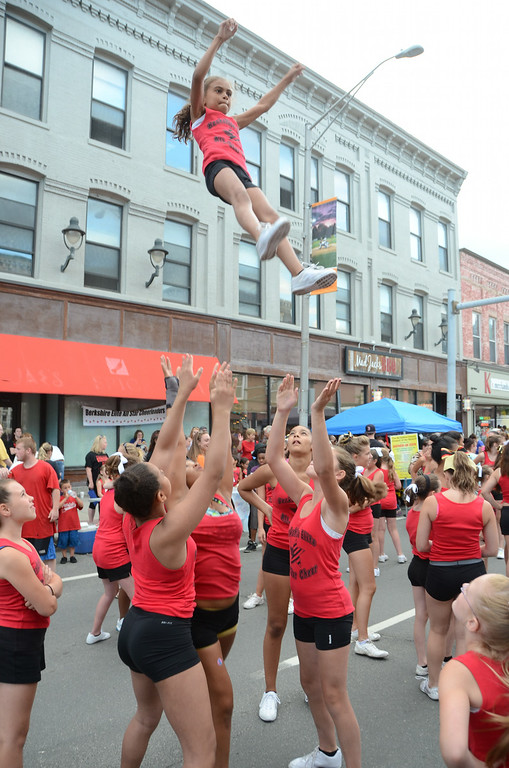 Description of . Alexis Henderson, 9, of the Berkshire Elite All Star Cheer Team is thrown up by her team during their performance on North Street for Third Thursday on July, 17, 2014. Gillian Jones / Berkshire Eagle Staff / photos.berkshireeagle.com