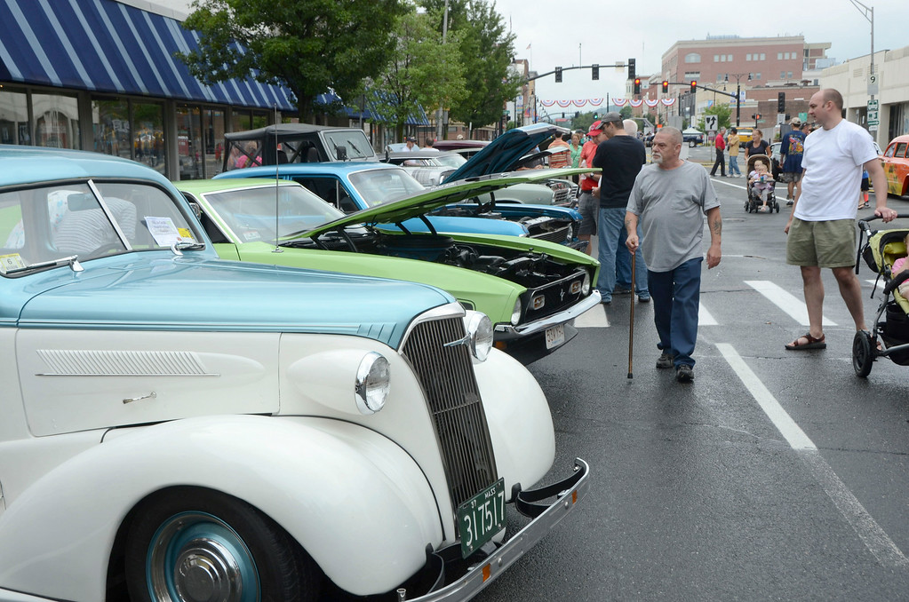 Description of . Hundreds of people check out the classic cars at the Pittsfield Ethnic Fair and Classic Car Show on North Street in Pittsfield on Sunday, July, 27, 2014. Gillian Jones / Berkshire Eagle Staff / photos.berkshireeagle.com