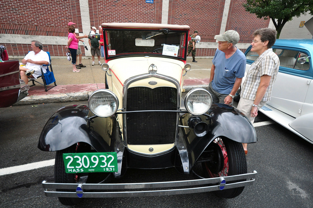 Description of . People look at this 1931 Ford Model A owned by Gene E. Hyatt of Richmond, at the Pittsfield Ethnic Fair and Classic Car Show on North Street in Pittsfield on Sunday, July, 27, 2014. Gillian Jones / Berkshire Eagle Staff / photos.berkshireeagle.com