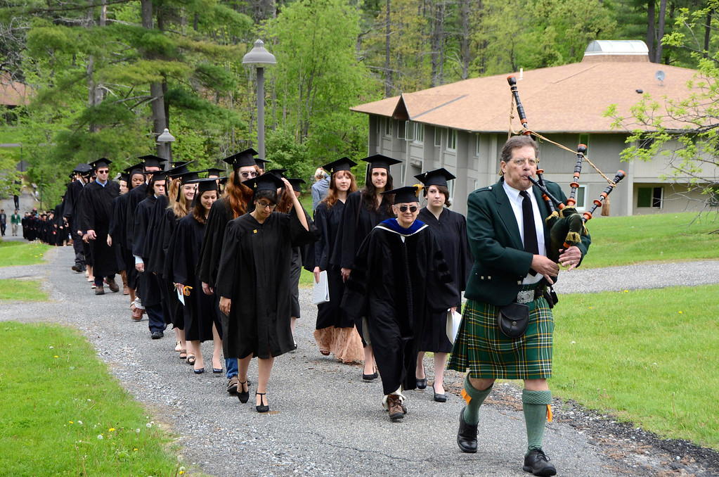 Description of . Bagpiper Brian Hopewell leads the procession of graduates during commencement exercises at Simon's Rock of Bard College on Monday, May, 26, 2014. Gillian Jones / Berkshire Eagle Staff / photos.berkshireeagle.com