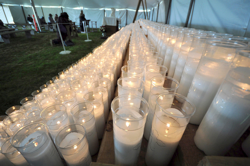 Description of . Hundreds of candles illuminate and warm the tent where worshipers could go for silent time at the Divine Mercy Sunday weekend on Sunday, April, 27, 2014 in Stockbridge. Gillian Jones / Berkshire Eagle Staff / photos.berkshireeagle.com