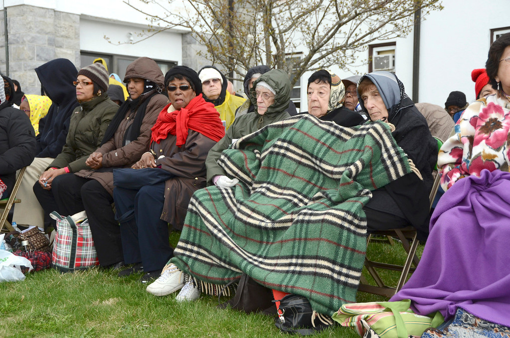 Description of . Thousands brave the rain and chilly weather to attend the Divine Mercy Sunday Solemn Liturgy on Sunday, April, 27, 2014 in Stockbridge. Gillian Jones / Berkshire Eagle Staff / photos.berkshireeagle.com
