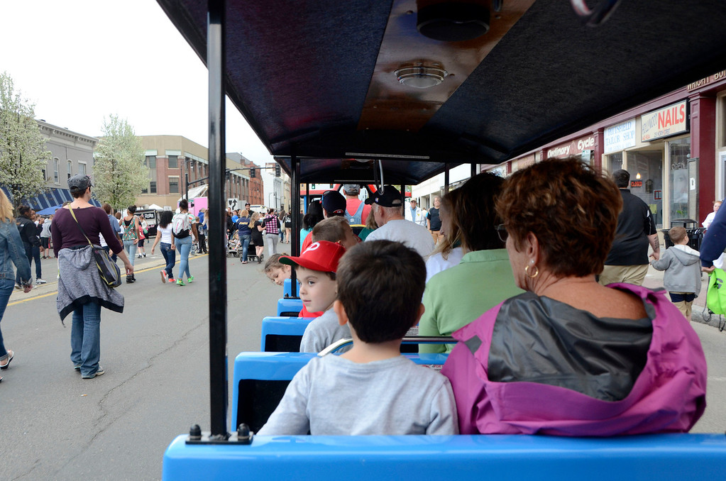 Description of . Children and their parents ride the choo choo train during the first Third Thursday of the season on May 15, 2014.  The train which costs $3 per person to ride is new this year. Gillian Jones / Berkshire Eagle Staff / photos.berkshireeagle.com