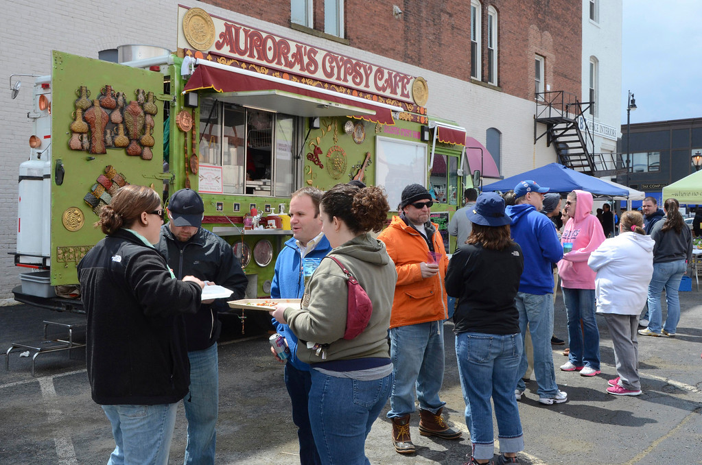 Description of . Dozens of people attend the food truck community event in Palace Park to benefit Moments House in Pittsfield on Sunday, May, 4, 2014. Gillian Jones / Berkshire Eagle Staff / photos.berkshireeagle.com