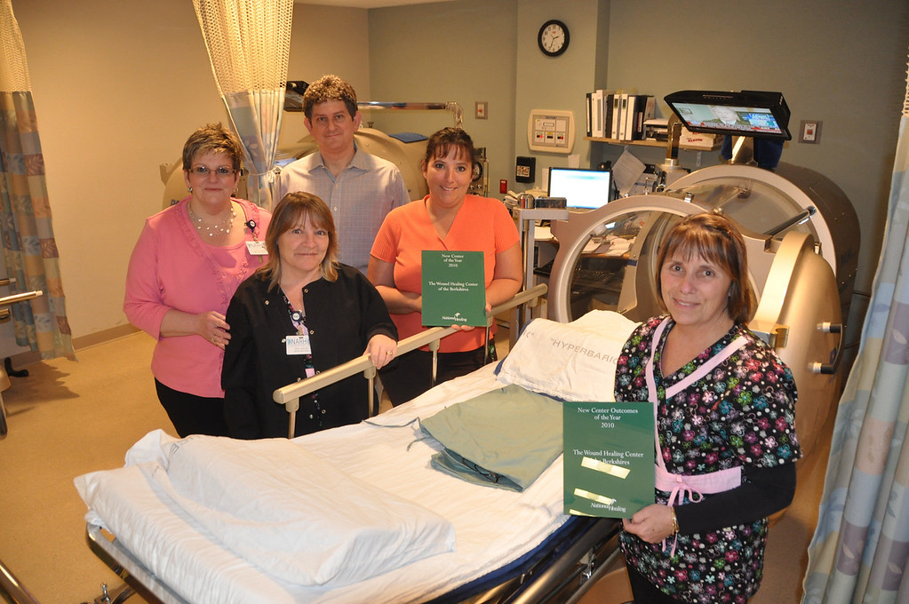 Description of . Gillian Jones/North Adams Transcript File Some of the staff of the award winning Wound Center at NARH stand with one of the two hyperbaric chambers. From left are Kelly Morse R.N., Joan Sadlow R.N., Dr. Fred Landes, Wendy Kelly and Ruth Lennon R.N.