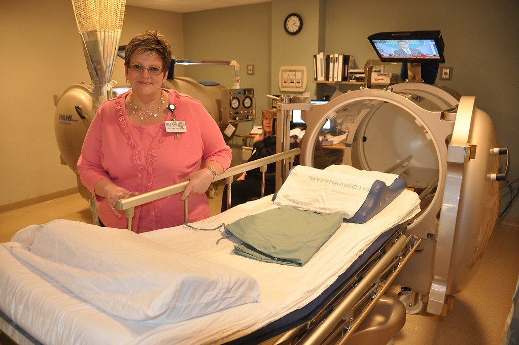 Description of . Gillian Jones/North Adams Transcript File Kelly Morse stands with one of the two hyperbaric chambers that North Adams Regional Hospital has in their Wound Center.