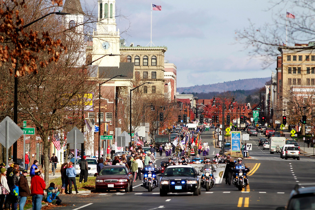 Description of . The Veterans Day parade makes its way down South Street to the war memorial in downtown Pittsfield on Monday, November 11, 2013. (Stephanie Zollshan | Berkshire Eagle Staff)