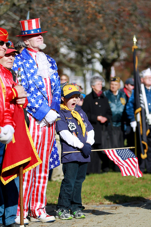 Description of . A Cub Scout takes in a big yawn after the Veterans Day parade at the war memorial on South Street in Pittsfield on Monday, November 11, 2013. (Stephanie Zollshan | Berkshire Eagle Staff)