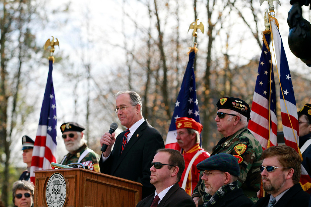 Description of . Mayor Daniel Bianchi speaks after the Veterans Day at the war memorial on South Street in Pittsfield on Monday, November 11, 2013. (Stephanie Zollshan | Berkshire Eagle Staff)
