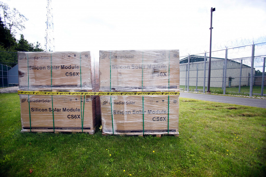 Description of . Solar cells ready to be installed at the Berkshire County House of Correction, that has received a large grant for energy improvement, including a photo voltaic field that is being built on a hill behind the facility. Thursday, August 14, 2014. Stephanie Zollshan / Berkshire Eagle Staff / photos.berkshireeagle.com