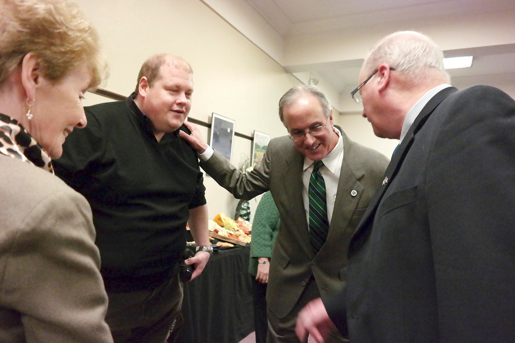 Description of . Pittsfield Mayor Dan Bianchi meets with the delegation for Ballina, I reland at a reception in City Hall. Left to right: Josie Egan, Mike Livings, Dan Bianchi and Williw Nolan, former Mayor of Ballina. Friday March 14, 2014. Ben Garver Berkshire Eagle Staff