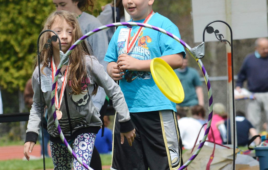 Description of . Alyssa LeFebvre, 7, tosses a frisbee through a ring at the Berkshire County Special Olympics held in Great Barrington, Wednesday May 7, 2014.  Ben Garver / Berkshire Eagle Staff / photos.berkshireeagle.com