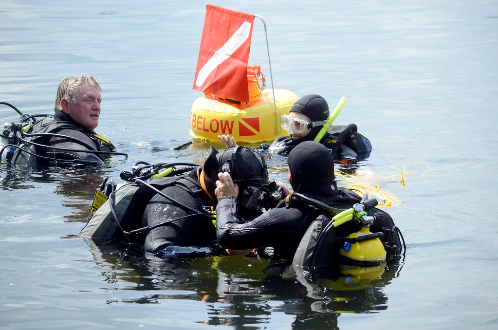 Description of . Members of the Berkshire County Sheriff department dive team prepare to search for a discarded handgun in Onota Lake, Wednesday Aug 20, 2014. The handgun in question was thrown in the lake after a man decided not to use it to take his own life three years ago. Ben Garver / Berkshire Eagle Staff / photos.berkshireeagle.com