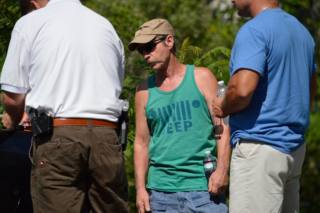 Description of . Jim Lusher attends the search for clues about the dissapearance of his son James at Greenwater Pond in Becket, Tuesday July 16, 2013. Ben Garver / Berkshire Eagle Staff