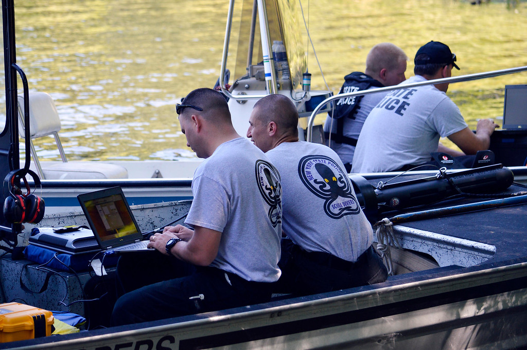 Description of . Police from  Massachusetts and New York State use laptops to monitor sonar of Greenwater Pond in Becket for the search  for clues related to the alleged abduction of James Lusher by Lewis Lent, Tuesday July 16, 2013. Ben Garver / Berkshire Eagle Staff