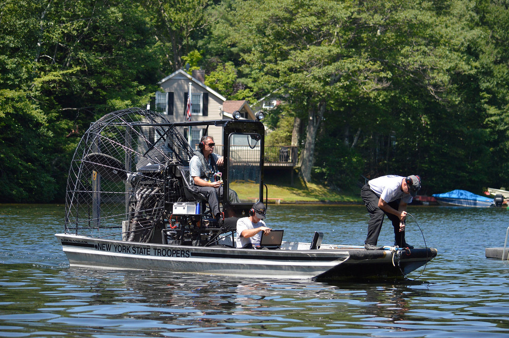 Description of . A boat  using side-scan sonar searches for clues related to James Lusher in Greenwater Pond in Becket, Tuesday July 16, 2013. Ben Garver / Berkshire Eagle Staff