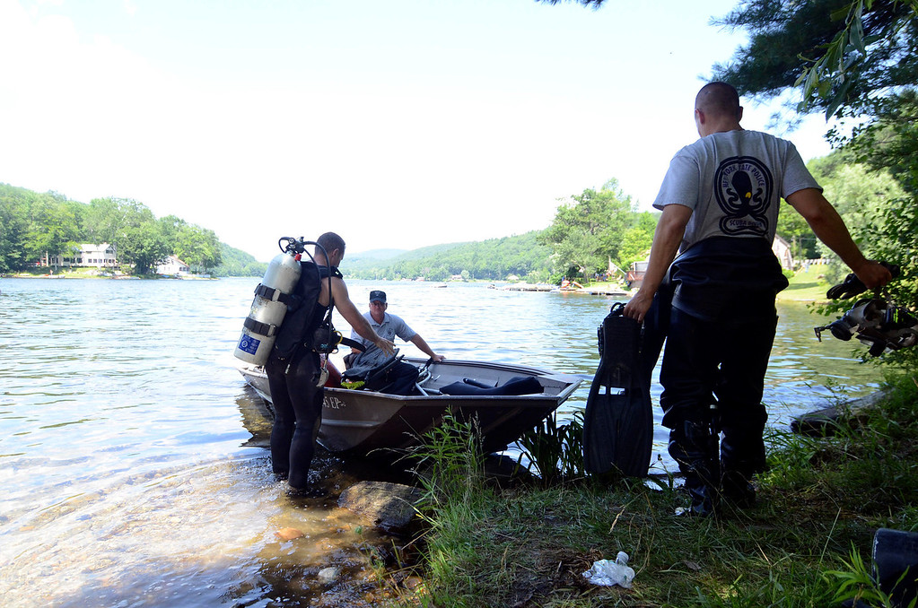 Description of . DIvers embark on a search of Greenwater Pond in Becket for clues related to another possable victim of Lewis Lent, James Lusher, Tuesday July 16, 2013. Ben Garver / Berkshire Eagle Staff