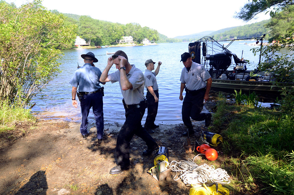 Description of . Investigators for the Massachusetts State Police embark on a search for clues pertaining to the alleged abduction of James Lusher by Lewis Lent at Greenwater Pond in Becket, Tuesday July 16, 2013. Ben Garver / Berkshire Eagle Staff