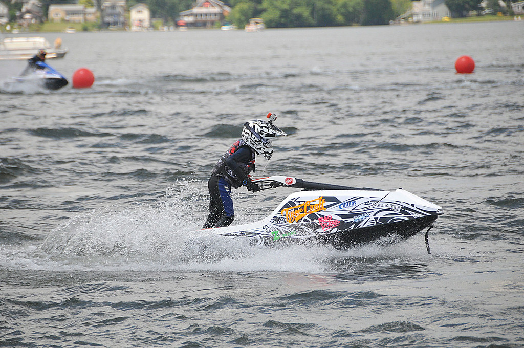Description of . A junior racer on his Jet Ski on Pontoosuc Lake during sanctioned races on Saturday, July 12, 2914 (Scott Stafford/Berkshire Eagle Staff)