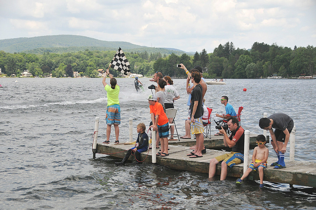 Description of . The checkered flag marks the finish of a Jet Ski race on Pontoosuc Lake during sanctioned races on Saturday, July 12, 2914 (Scott Stafford/Berkshire Eagle Staff)