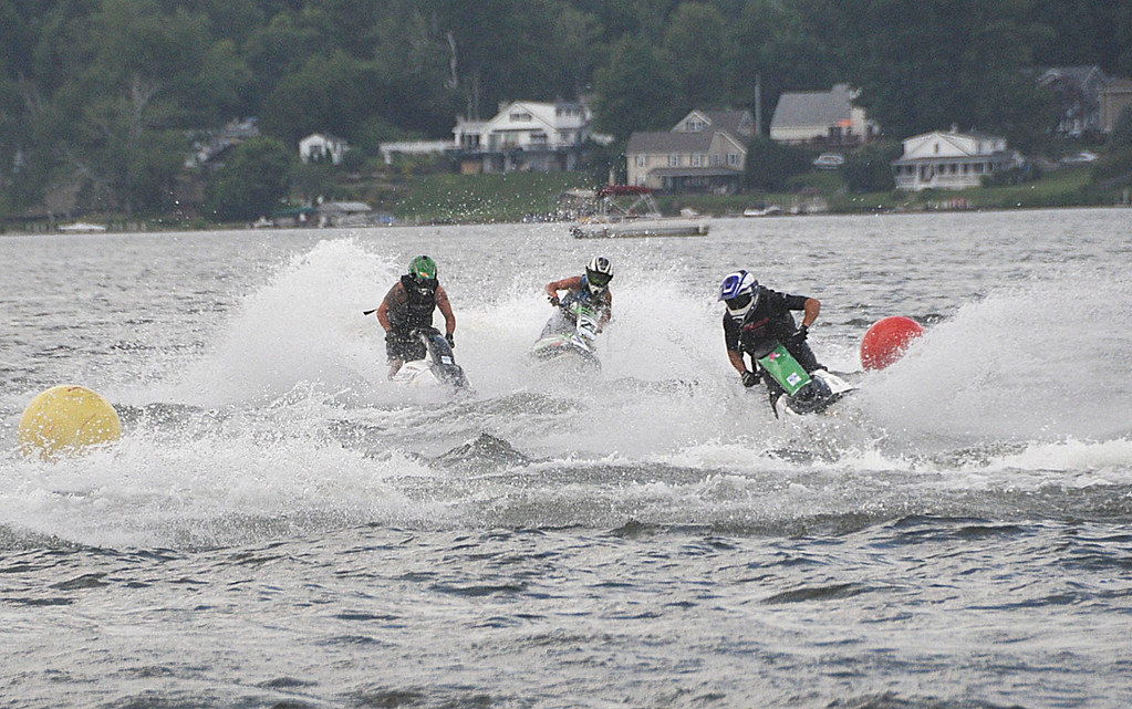 Description of . Racers run their Jet Skis on Pontoosuc Lake during sanctioned races on Saturday, July 12, 2914 (Scott Stafford/Berkshire Eagle Staff)