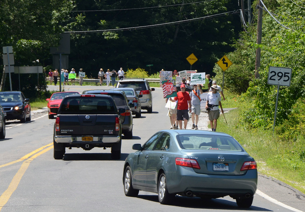 Description of . Dozens of protesters march along Route 295 in Richmond in resistance to Kinder Morgan's Tennessee Gas Co. pipeline expansion on Sunday, July 6, 2014. Gillian Jones / Berkshire Eagle Staff / photos.berkshireeagle.com
