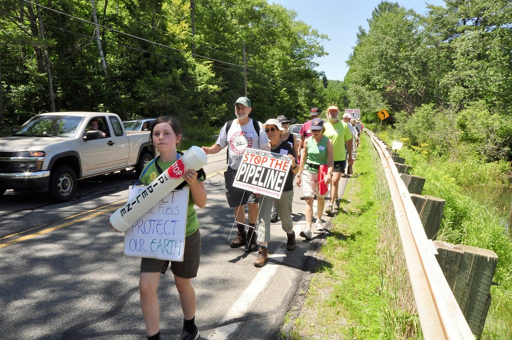 Description of . Dozens of protesters march in resistance to Kinder Morgan's Tennessee Gas Co. pipeline expansion on Sunday, July 6, 2014. Gillian Jones / Berkshire Eagle Staff / photos.berkshireeagle.com