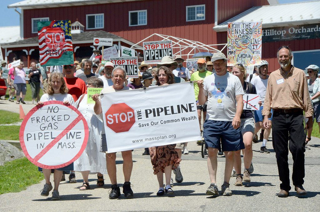 Description of . Dozens of protesters march from Hilltop Orchards on Route 295 in Richmond in resistance to Kinder Morgan's Tennessee Gas Co. pipeline expansion on Sunday, July 6, 2014. Gillian Jones / Berkshire Eagle Staff / photos.berkshireeagle.com