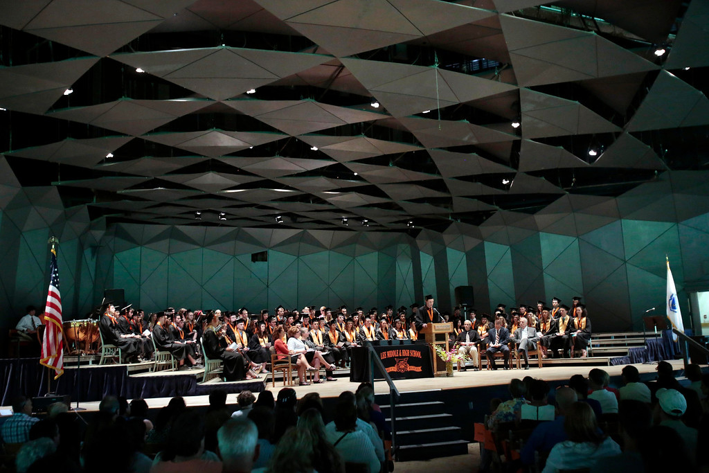 Description of . The class of 2014 assembles on stage in the shed for the Lee High School gradation ceremony at Tanglewood in Lenox. Saturday, June 7, 2014. Stephanie Zollshan / Berkshire Eagle Staff / photos.berkshireeagle.com